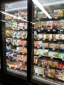 supermarket freezer stocked with packaged food