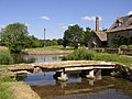 Very old stone footbridge over river at Lower Slaughter - geograph.org.uk - 1194848.jpg