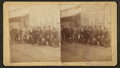 View of African American shoe shine boys posing along the streetcar tracks, by M.M. & W.H. Gardner.png