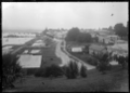 View of Tauranga from the Redoubt showing a street on the waterfront, 1924. ATLIB 296457.png