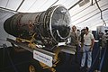 Visitors attending the rollout ceremony for the first production model B-1B aircraft examine a model of a F101 turbofan jet engine at the Rockwell International facility. Four F-101 engines power the B-1B.jpg