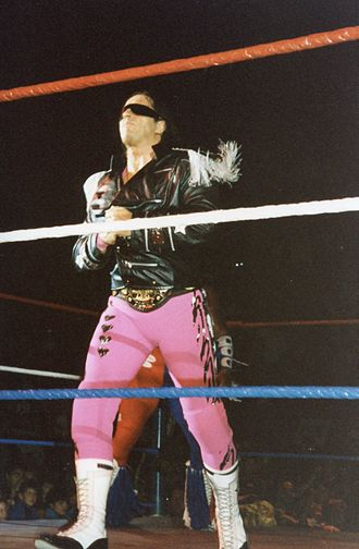 Bret Hart - Hart with his WWF World Heavyweight Championship belt underneath his jacket