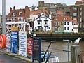 Whitby Harbour, with posters in foreground.JPG