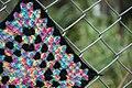 Yarn bomb - granny square on fence (5521346268).jpg