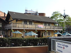 The current Ye Olde Swiss Cottage public house