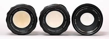 Yellowed thorium dioxide lens (left), a similar lens partially de-yellowed with ultraviolet radiation (centre), and lens without yellowing (right) Yellowing of thorium lenses.jpg