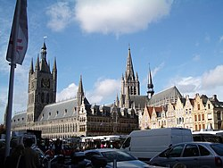Ypres town centre. View across the crowded marketplace to the rebuilt Cloth Hall, location of the In Flanders Field Museum.