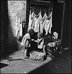 """Children In Naples, Italy"". Little neapolitan girls. Photographed by Lieutenant Wayne Miller, July 1944. U.S. Navy Photograph, now in the collections of the National Archives.jpg"