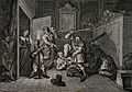 .Two men wearing masks club Hudibras, as Ralphos, removing h Wellcome V0049156.jpg