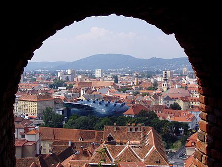 City overview from Schlossberg with Kunsthaus in the middle 07 Graz, Austria.jpg