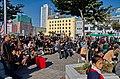 0910 - Nordkorea 2015 - Pjöngjang - Public Viewing am Bahnhofsplatz (22789252090).jpg