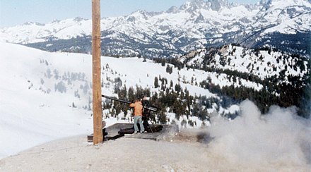 Forest Service team uses a 106 mm Recoilless Rifle for avalanche control at Mammoth Mountain in the Inyo National Forest in California. Note the Minarets in background. - United States Forest Service