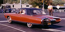 Red Chrysler Turbine Car in a parking lot