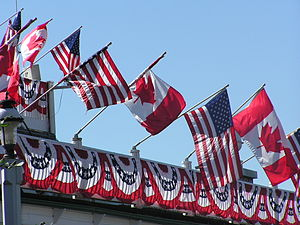 Bunting (textile) - 4th of July decorations in Roche Harbor include Canadian and American flags and red, white and blue bunting.