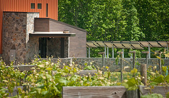 Leadership in Energy and Environmental Design - Grapevines and photovoltaic panels (r.) rely on the sun at Cooper Vineyards in Louisa, Virginia, the first winery on the East Coast and the second in the country awarded the fourth and highest, Platinum certification by Leadership in Energy and Environmental Design (LEED)