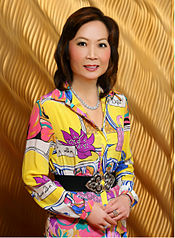 Chinese woman wearing brightly colored 1980s-inspired dress 30e8330af3fa