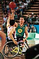 221000 - Wheelchair basketball Adrian King shoots - 3b - 2000 Sydney match photo.jpg