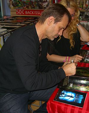 The Abyss - Star Michael Biehn signing a copy of the film's DVD cover during an August 23, 2012, appearance at Midtown Comics in Manhattan.