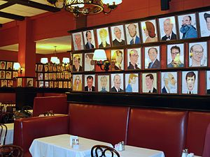 Sardi's - The ground floor dining room, with celebrity caricatures lining the upper walls.