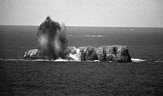 Bombing range - A 1,000 pound bomb hitting a small island being used as a bomb target