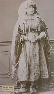 A Lady from Jeddah , This photograph was taken in 1873. It shows the traditional women clothes in the past.