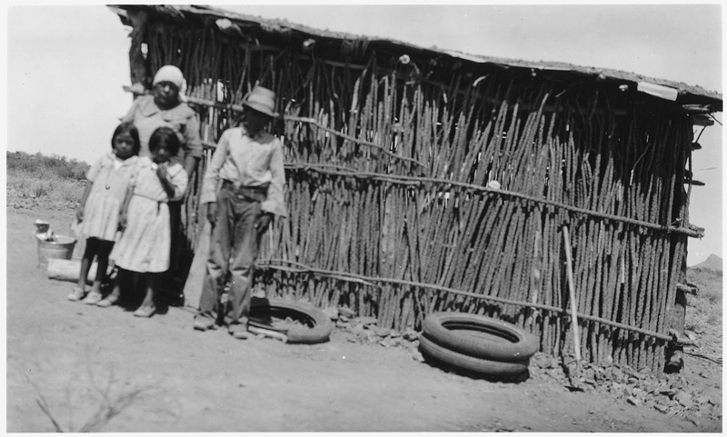File:A Papago family of four standing in front of home made of twigs on Sells Indian Reservation, Sells, Arizona. - NARA - 295246.tif