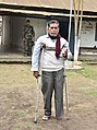 A physically challenged voter showing his voter identity card, at a polling booth, during the Nagaland Assembly Election, in Dimapur on February 27, 2018.jpg