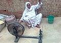 A village lady weaving cotton in Pakistan.jpg