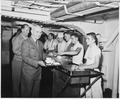 Accompanied by George Drescher, President Harry S. Truman carried his lunch tray through the chow line in the crew's... - NARA - 198742.tif