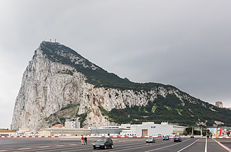 Gibraltar International Airport - Winston Churchill Avenue crossing the runway with the rock in the background