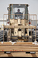 Air Transportation Airmen From the 380th Expeditionary Logistics Readiness Squadron's Air Terminal Operations Center Drives a 60,000-pound-capable Aircraft Loader to Unload a Plane During Operations DVIDS290888.jpg