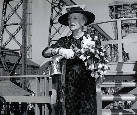 Alice Roosevelt Longworth christening the submarine named after her father, the USS Theodore Roosevelt, in 1959 Alice Roosevelt Christens Sub TR.jpg