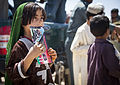 An Afghan child watches as Afghan National Civil Order Police (ANCOP) officers hand out radios and comic books to residents in Delaram, Helmand province, Afghanistan, May 26, 2013 130526-M-RO295-164.jpg