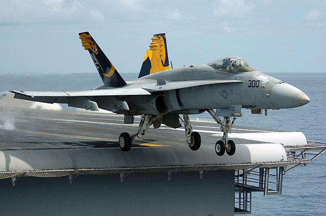 640px-An_F-A-18C_Hornet_launches_from_th