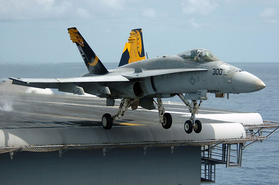 An F-A-18C Hornet launches from the flight deck of the conventionally powered aircraft carrier