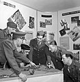 An officer at a camouflage school instructs British and US servicemen on points relating to concealment on the battlefield, 1943. D13667.jpg