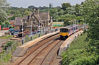 Appley Bridge railway station serves the villages of Appley Bridge and Shevington, both in Metropolitan Borough of Wigan, England