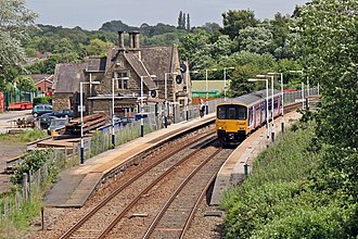 Appley Bridge railway station - Appley Bridge station in 2015, with a Northern Rail Class 150 at the Southport-bound platform, seen from the Appley Lane North road bridge.