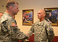 Army Command Sgt. Maj. James Wills, left, senior enlisted leader of 80th Training Command, congratulates Sgt. 1st Class Michael Pike, an instructor with 1st Battalion, 31st Regiment, 102nd Division, and winner 121013-A-ZZ999-003.jpg