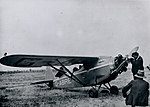 Arthur Butler servicing his Comper Swift aeroplane G-ABRE in field, 1931.jpg
