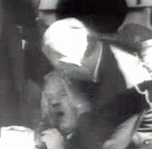 Hendrik Verwoerd - A man attempts to stop Verwoerd's bleeding immediately after the assassination attempt