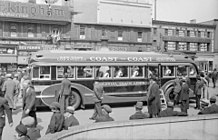 Colonial Coach Lines bus on the square of the Phillips Street in Montreal,1937.