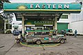 Banaue Philippines Fuel-station-with-jeepney-01.jpg