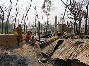 2013 Bangladesh anti-Hindu violence - Hindu women in Banshkhali Upazila surveying the remains of their demolished homes after being attacked by the Bangladesh Jamaat-e-Islami.