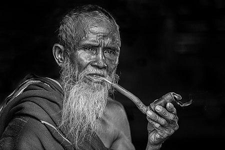 Bearded man smoking pipe