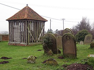 Wrabness - wooden bell cage, Wrabness church yard