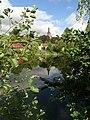 Bernartice, pohled před rybník ke kostelu svatého Petra a Pavla.jpg