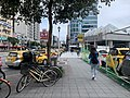 Bicycles and taxis in front of the main entrance of Minquan West Road Station 20201207.jpg