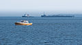 Boat and tugboat pulling barge.jpg