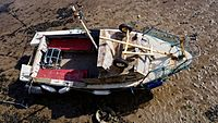 Boat at low tide in the harbour of Margate Kent England 2.jpg